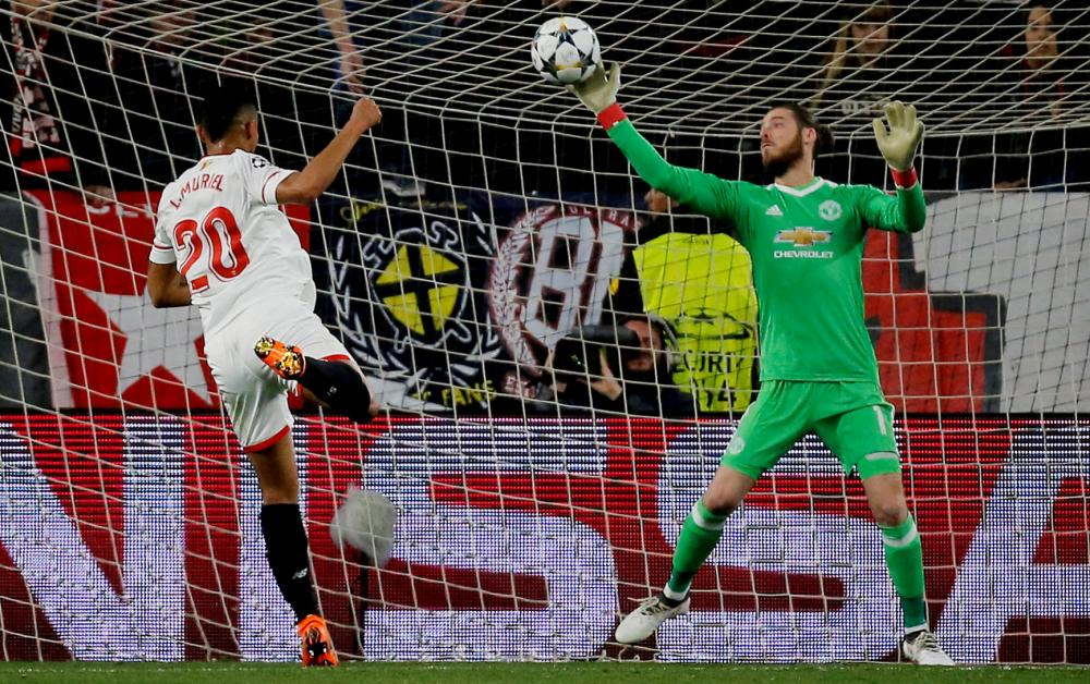 David de Gea, here denying Luis Muriel, saved Manchester United from defeat at Sevilla.