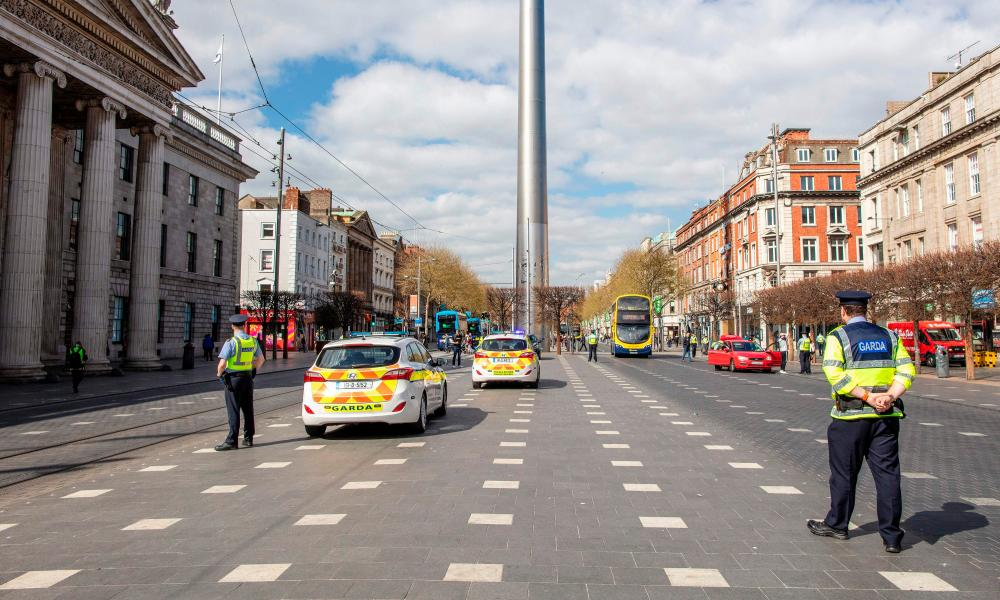 Garda officers conduct checks on pedestrians and motorists in Dublin city centre on April 8.