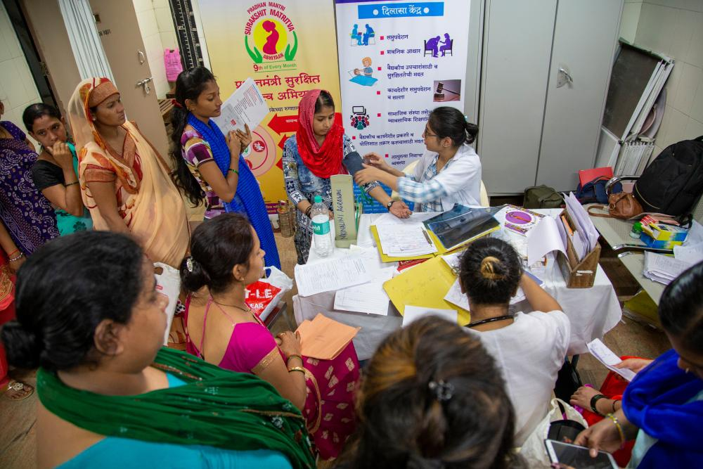 small hospital room filled with women coming to get checkups