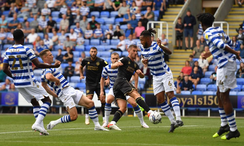 Reading's Michael Morrison (second left) scores an own goal to give the visitors the lead.