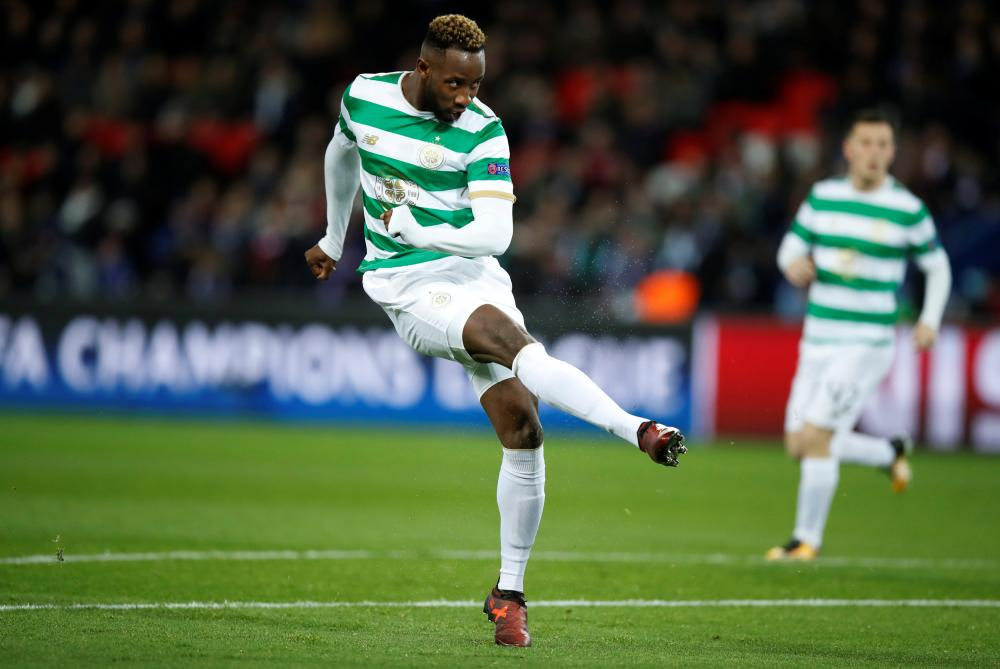 Celtic's Moussa Dembele scores their first goal.