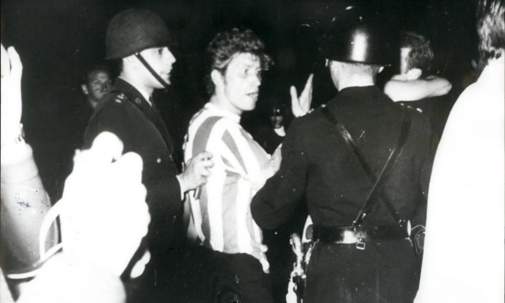 Police speak to an Estudiantes player.