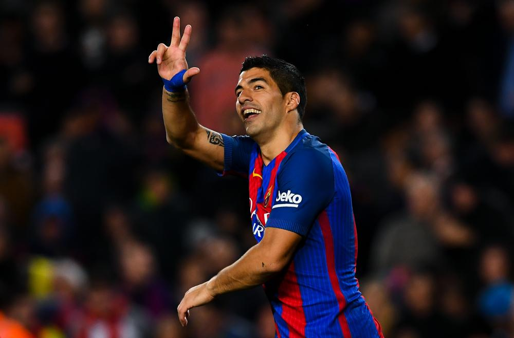 Luis Suarez celebrates after scoring Barça's third goal.