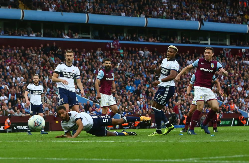 James Chester of Aston Villa turns a shot the wrong side of the Boro upright.