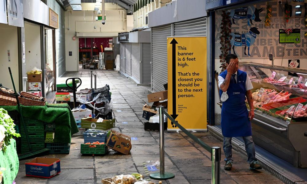 A sign asking customers to observe social distancing measures and stay two meters apart at Kirkgate market in Leeds. In England from today outdoor markets can open.