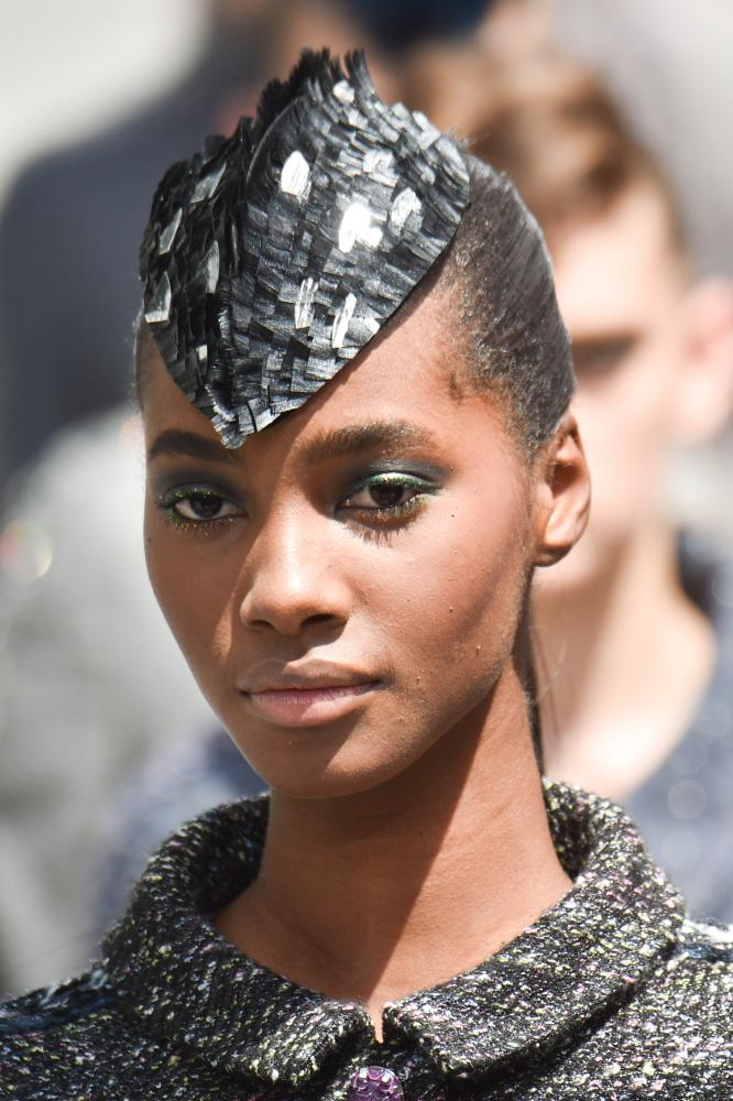 A bold Chanel headpiece.