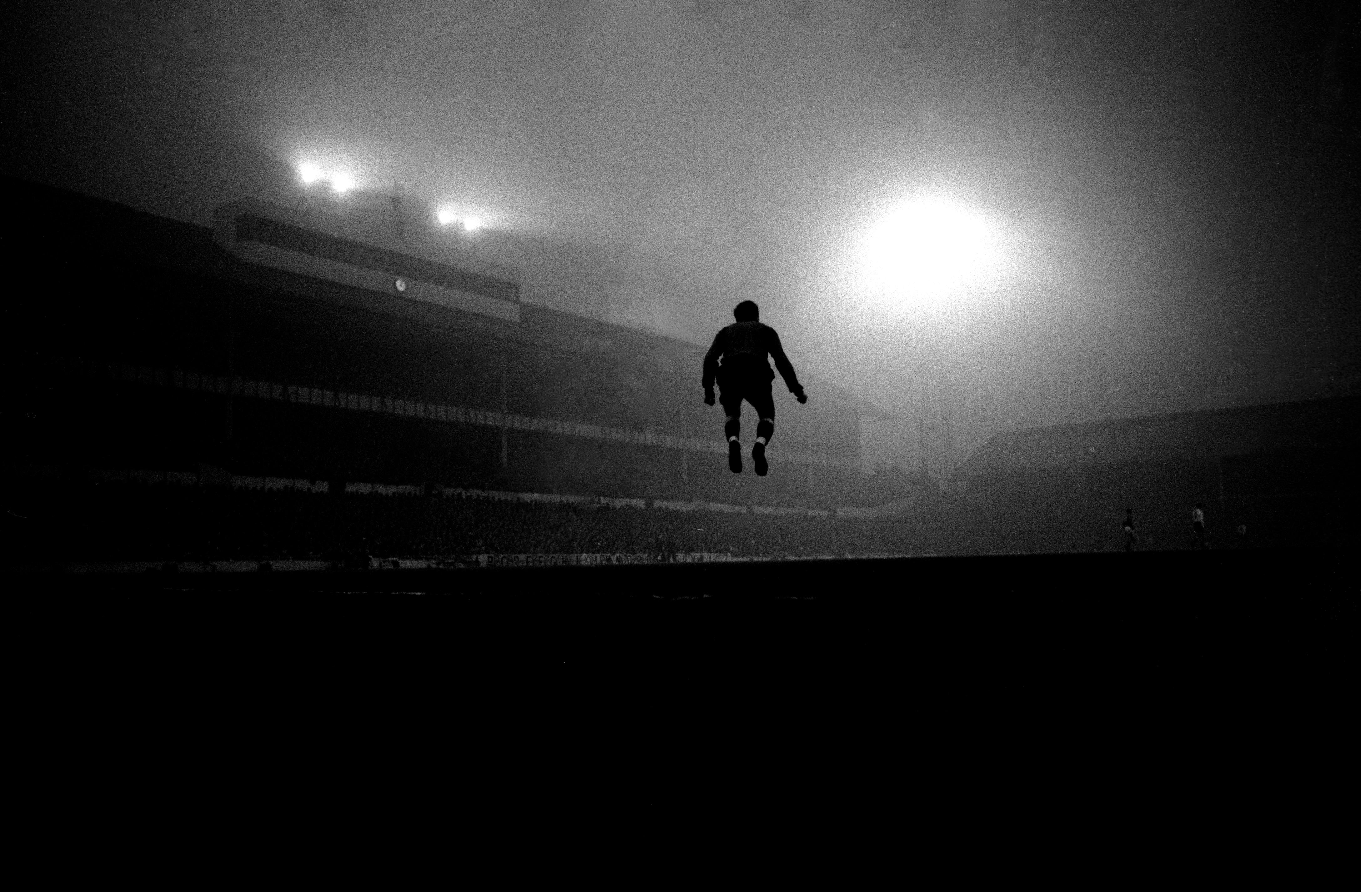 Buy a classic sport photograph: jumping in the fog at White Hart Lane