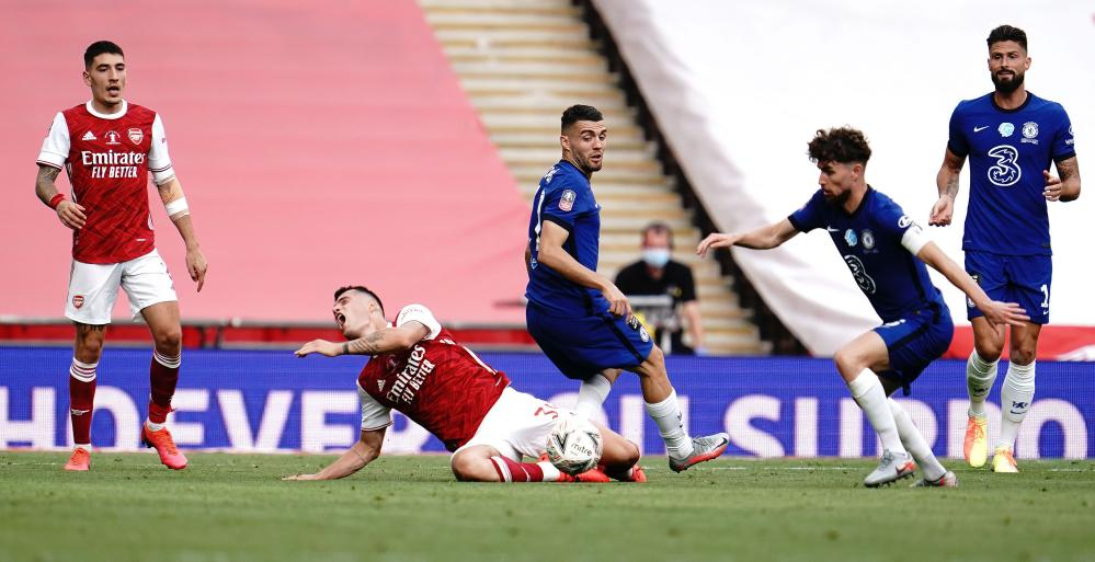 Mateo Kovacic of Chelsea tackles Granit Xhaka of Arsenal and gets an early bath after receiving his second yellow card.