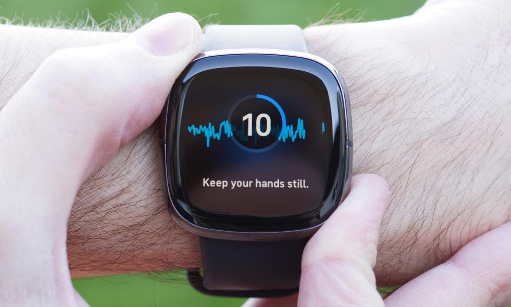 Fitbit Sense on wrist, showing ECG feature