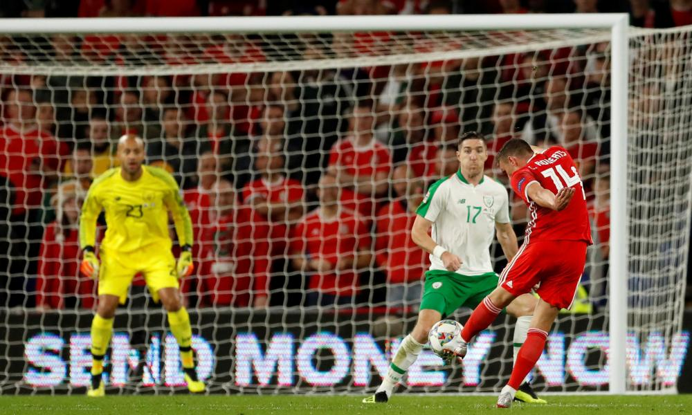 Wales' Connor Roberts fires the ball home after setting himself up nicely with a deft little touch. scores their fourth goal.