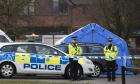 Police cordon near a forensic tent in Salisbury, England, where Sergei and Yulia Skripal were found.