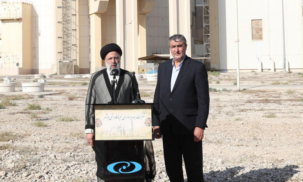 Iran's president, Ebrahim Raisi, and its atomic energy association head, Mohammad Eslami, at Bushehr nuclear power plant in Tehran on 8 October. Eslami has told state media Iran has 120kg of 20% enriched uranium