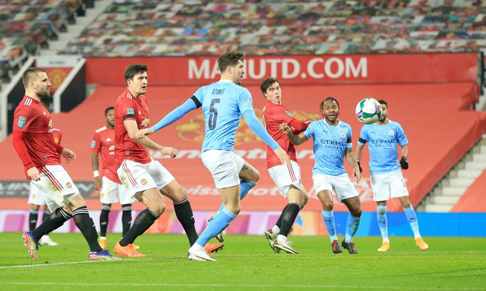 John Stones of Manchester City scores their team's first goal .
