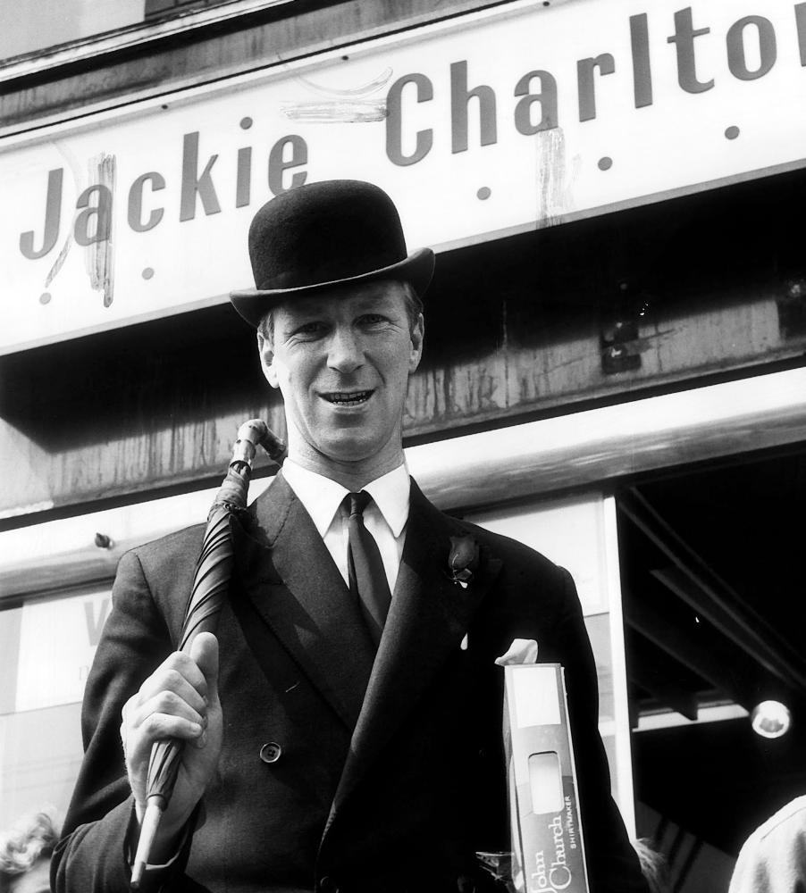 Jack Charlton wears a suit and bowler hat outside a shop his name on it 1967.