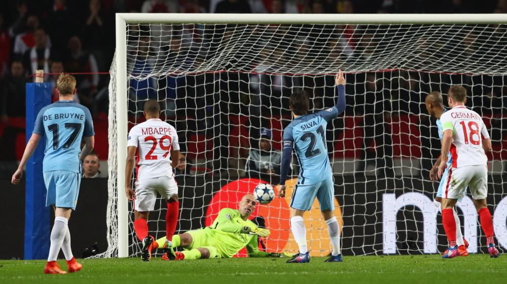 Kylian Mbappe prods the ball past City goalkeeper Willy Cabellero to give Monaco an early lead.