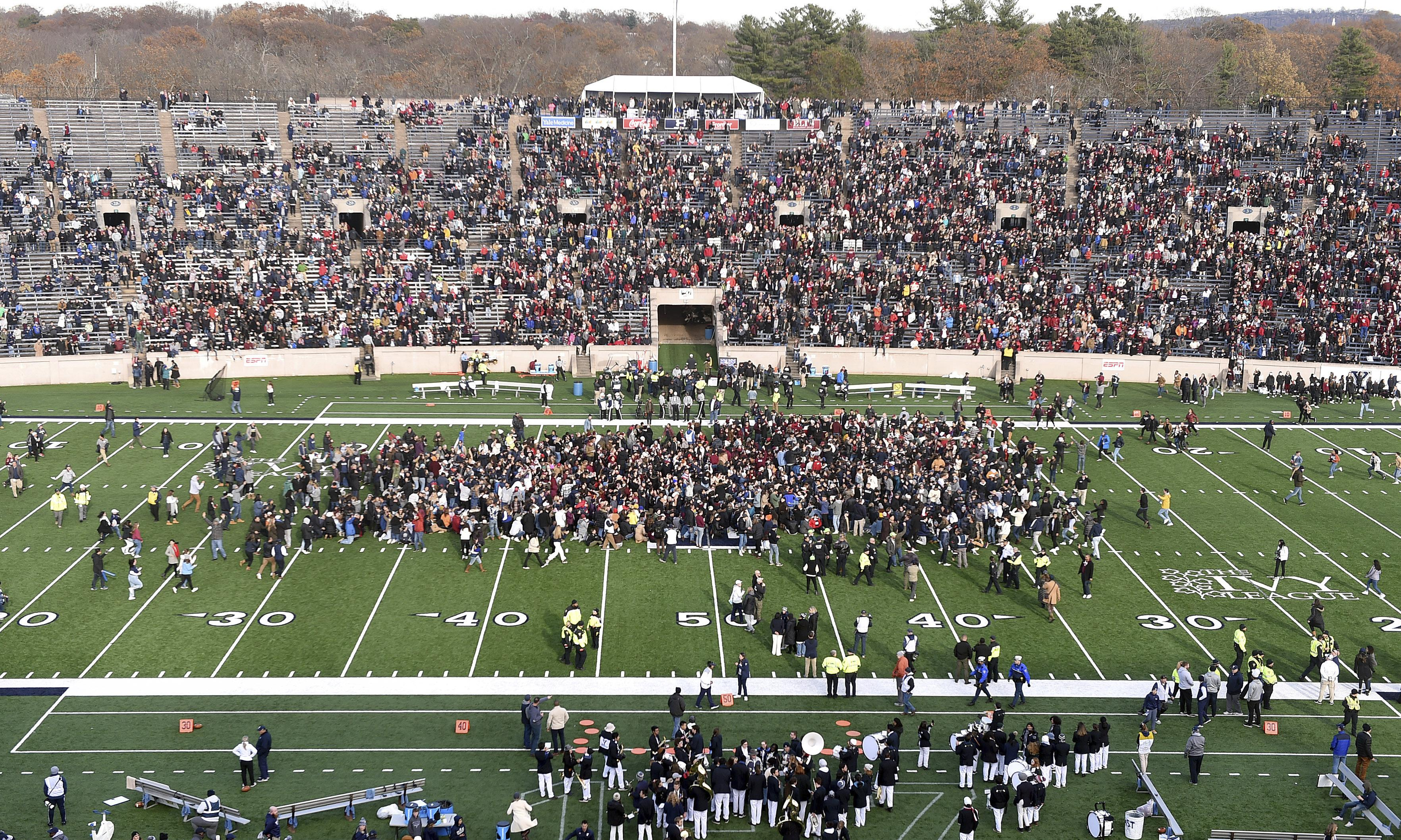 Harvard and Yale students disrupt football game for fossil fuel protest
