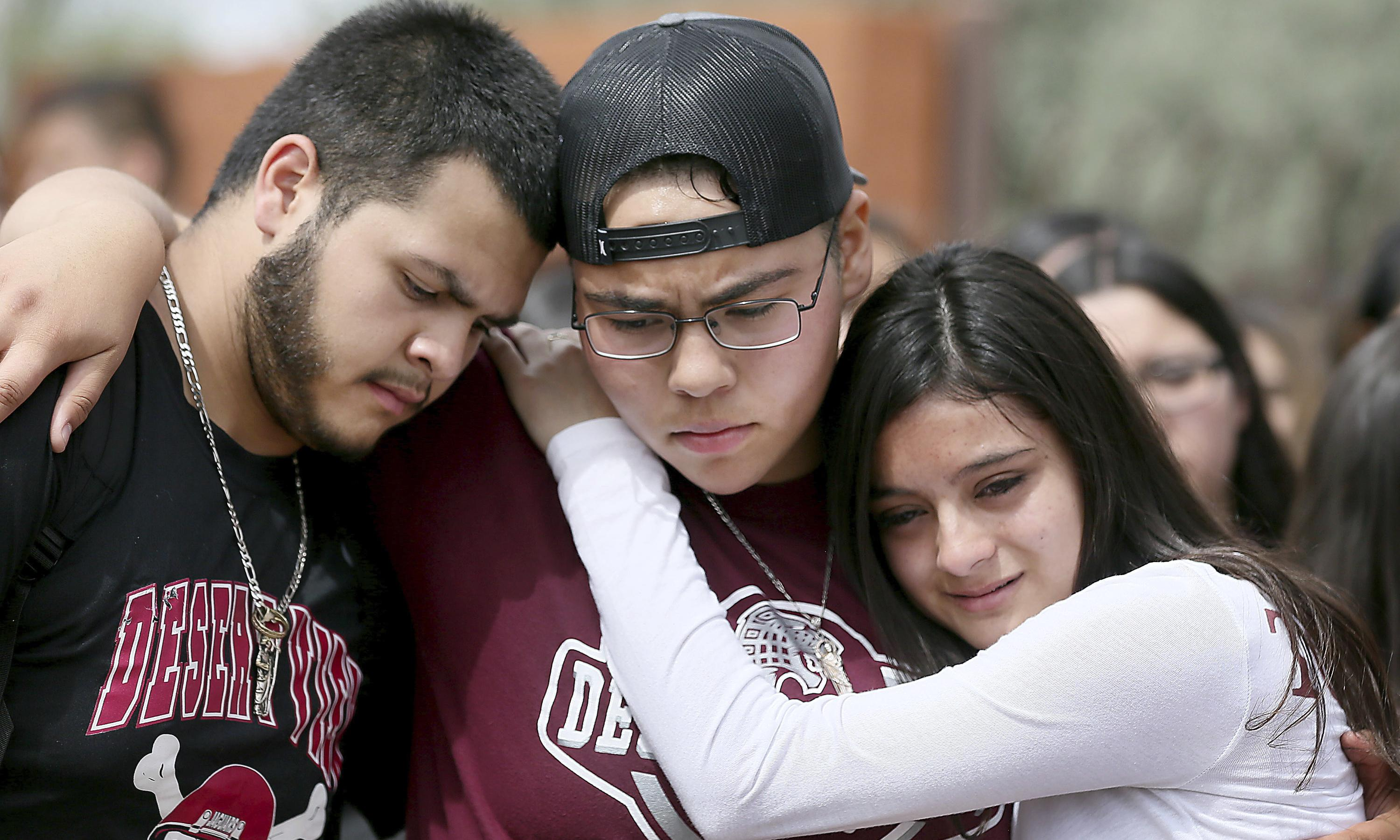 Arizona students march to protest football player's potential deportation