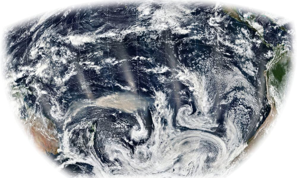 A satellite image showing long, thin plumes of smoke from bushfires burning in Australia stretching across the Pacific Ocean in January 2020