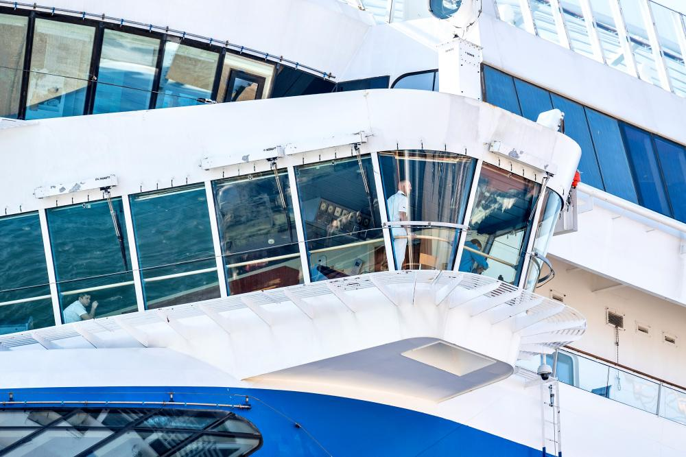 Crew members on board the Italian-registered cruise ship Aidadiva, which is docked in the harbour of Skagen, Denmark, 6 April 2020