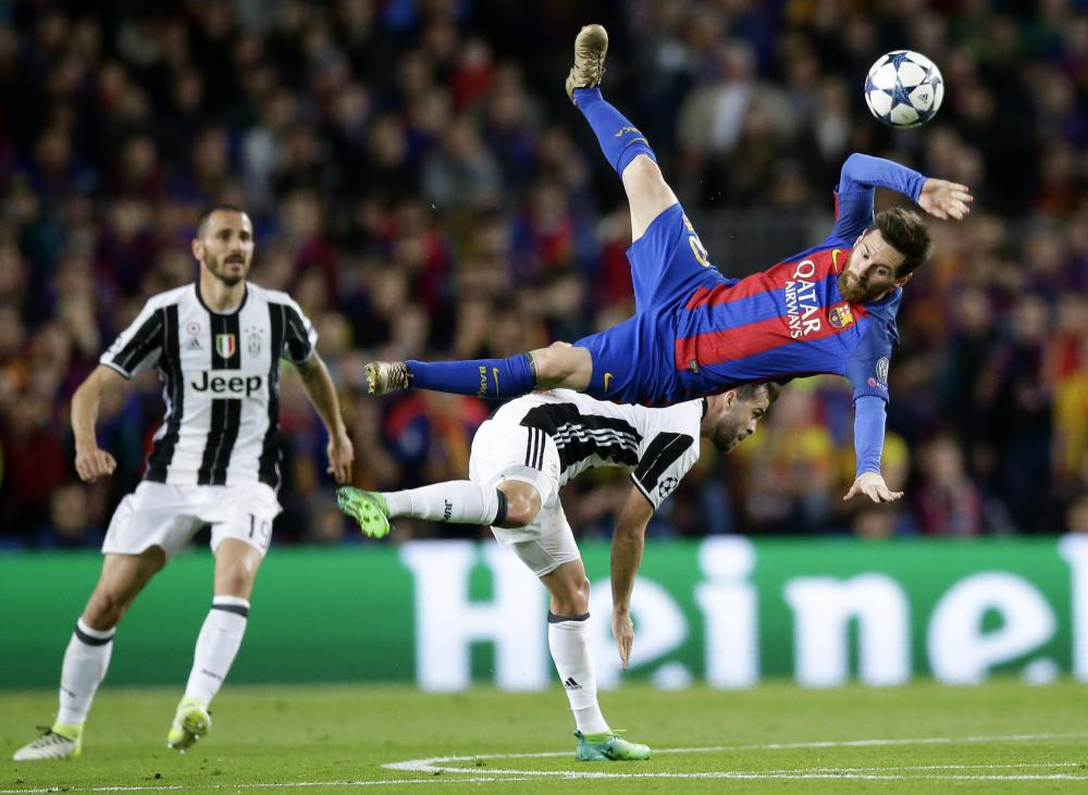 Messi, airborne after being challenged by Pjanic.