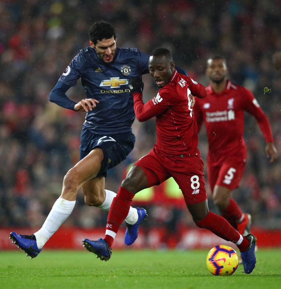 Naby Keita battles for possession with Marouane Fellaini