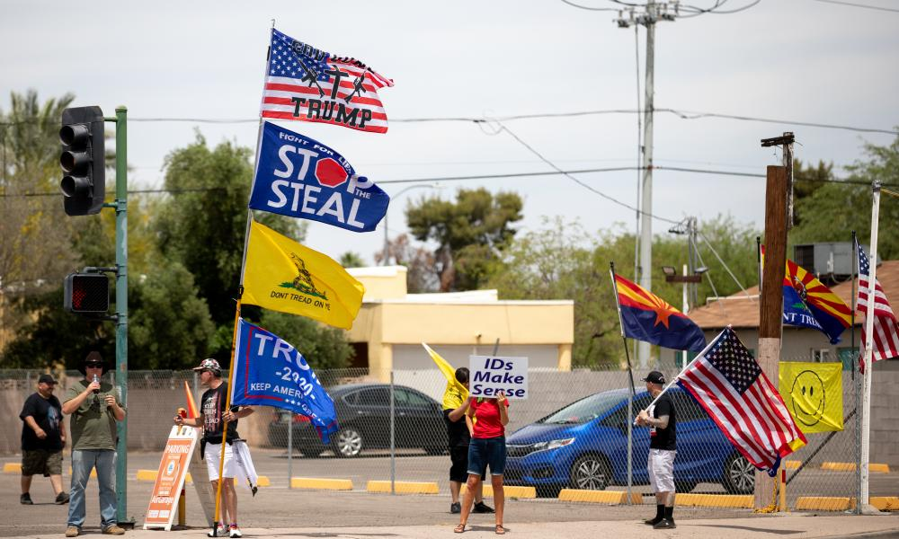 Trump supporters outside the Veterans Memorial Coliseum in Phoenix in May. 'The investigation hasn't boosted confidence in the election results. It's only further weakened it.'
