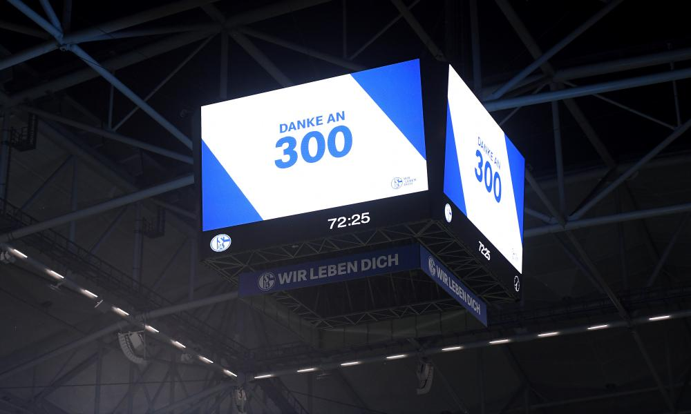 A video screen at the Veltins Arena displays the official attendance.