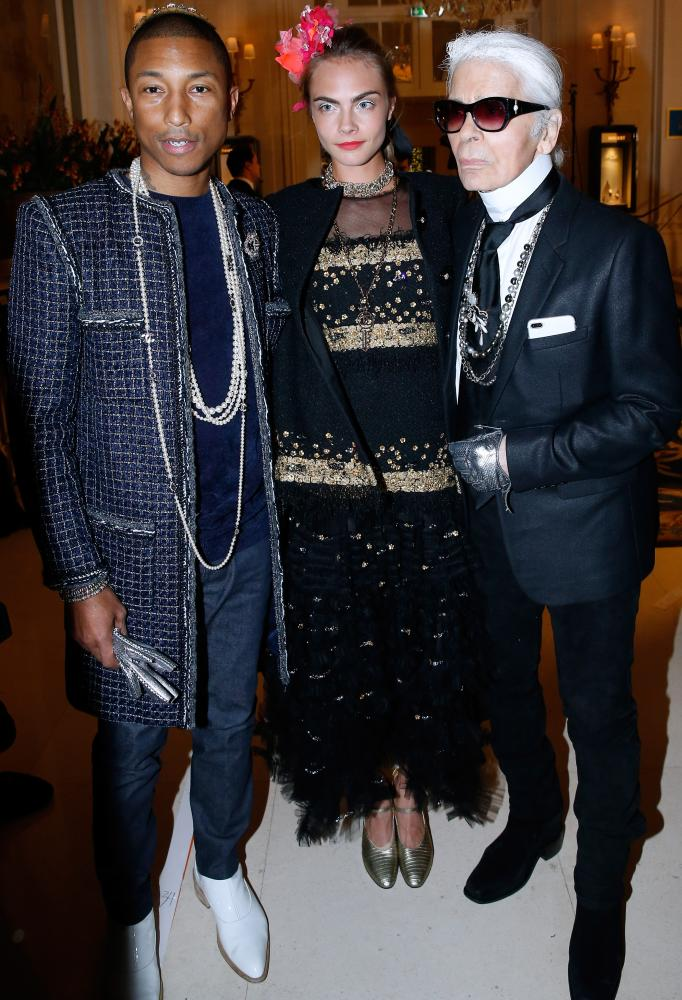 Pharrell Williams, left, with model Cara Delevingne and designer Karl Lagerfeld, right, at the Chanel show.