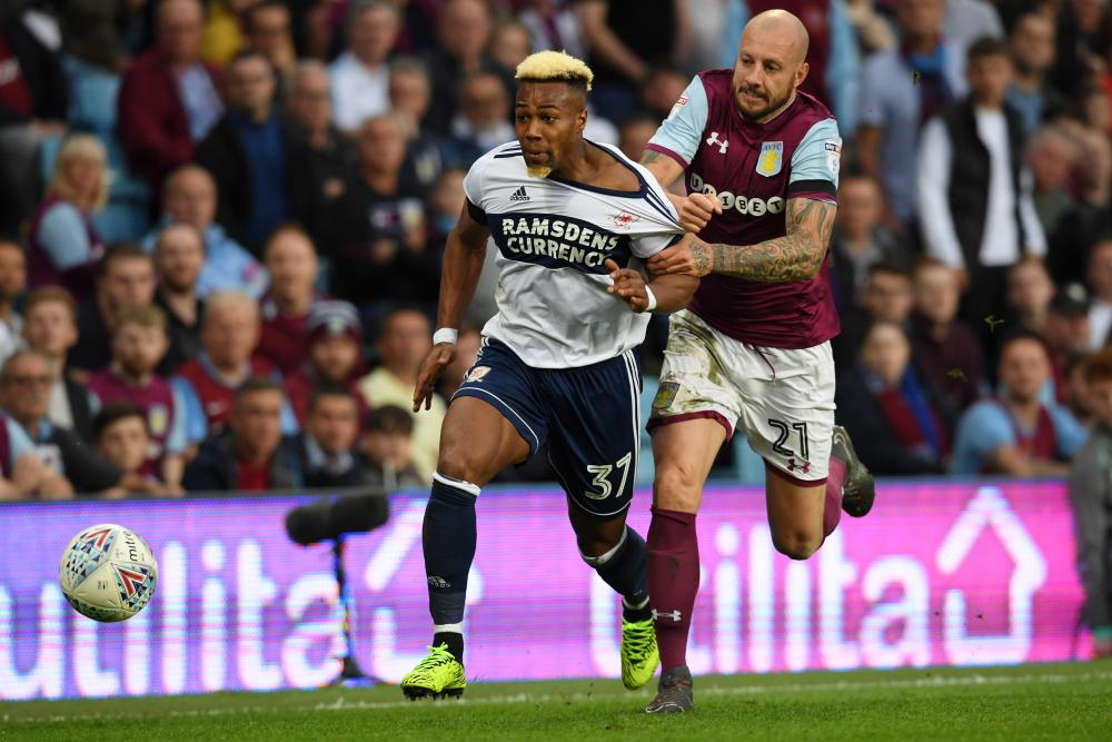 Alan Hutton of Aston Villa pulls the shirt of Boro's Adama Traore and earns himself a place in the ref's book.