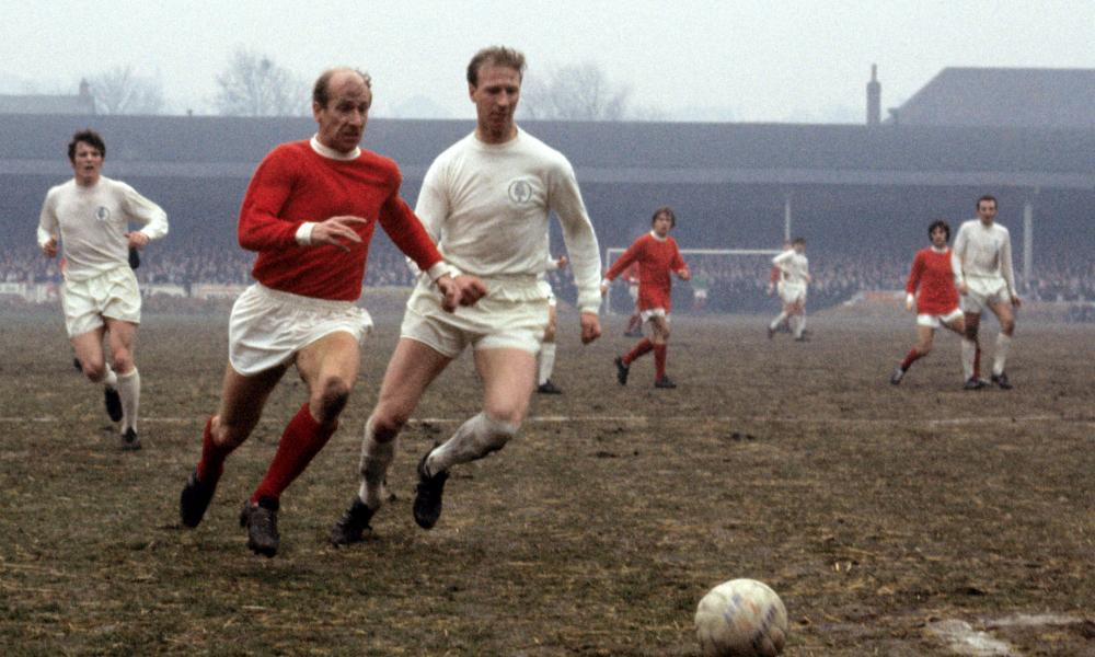 Jack and Bobby Charlton compete on the pitch as Leeds play Manchester United in 1969.