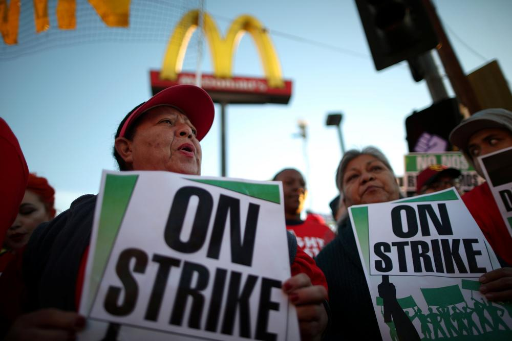 People participate in a 'Fight for $15' wage protest in Los Angeles, California.