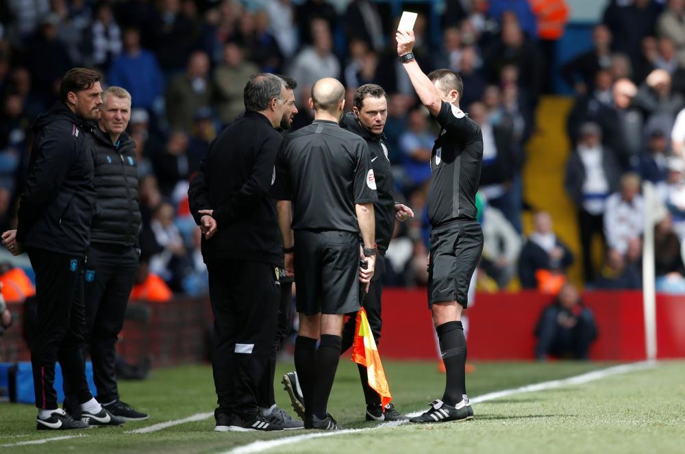 Bielsa is shown a yellow card by referee Stuart Attwell.