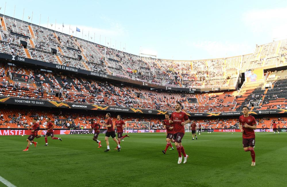 Arsenal players warm up in the Estadio Mestalla. 50,000 fans will create an atmosphere inside the cauldron.