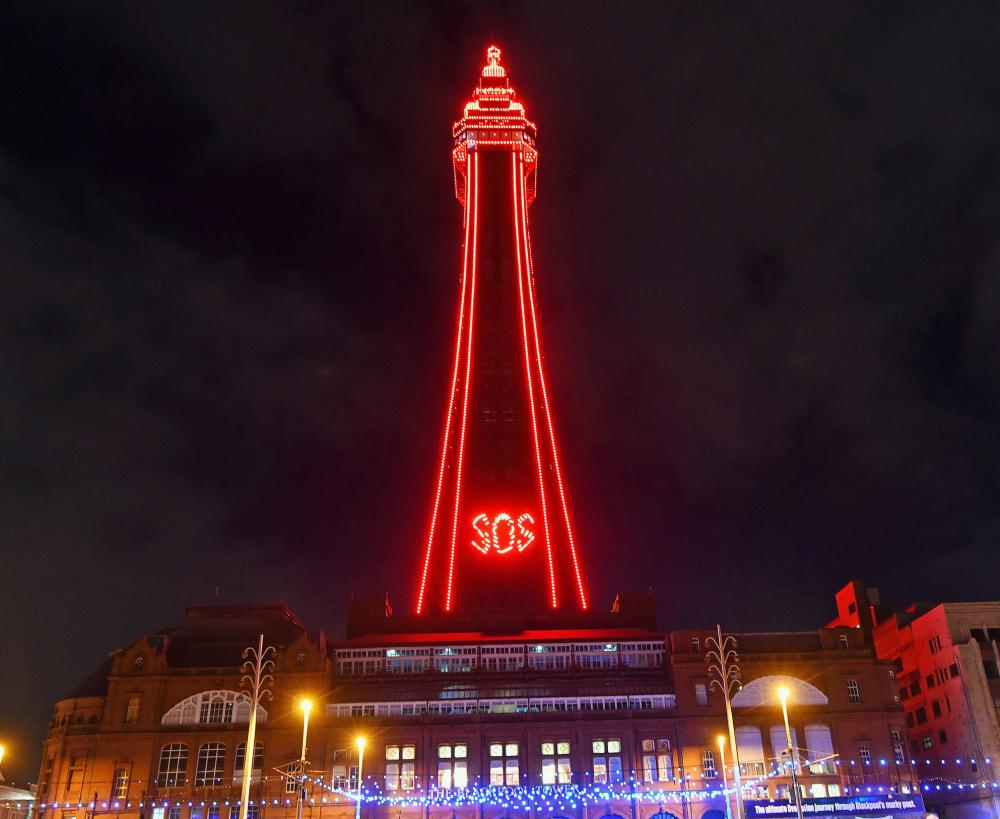 Blackpool Tower lit up with the message SOS to highlight the plight of the tourism industry, as more than 1,000 businesses have written to Boris Johnson to call for extra support for the resort while it is subject to tier 3 restrictions.