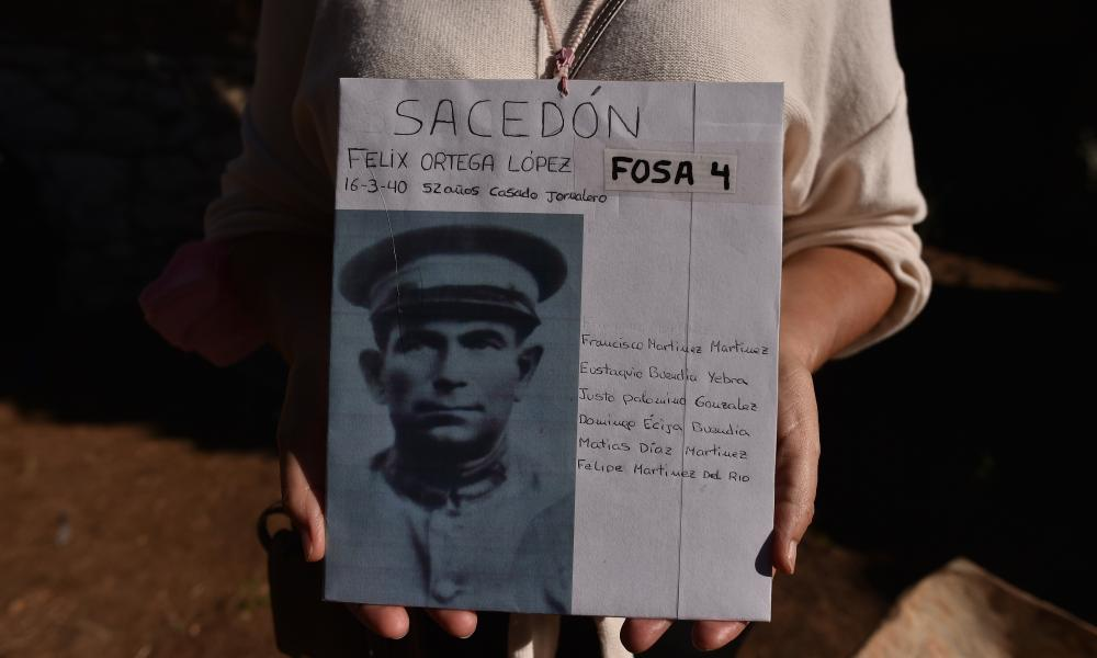 Maria Angeles Ortega Gonzalo holds a photograph of her grandfather's cousin Felix Ortega Lopez who was executed on 16 March 1940 by Franco's forces at the municipal cemetery in Guadalajara.