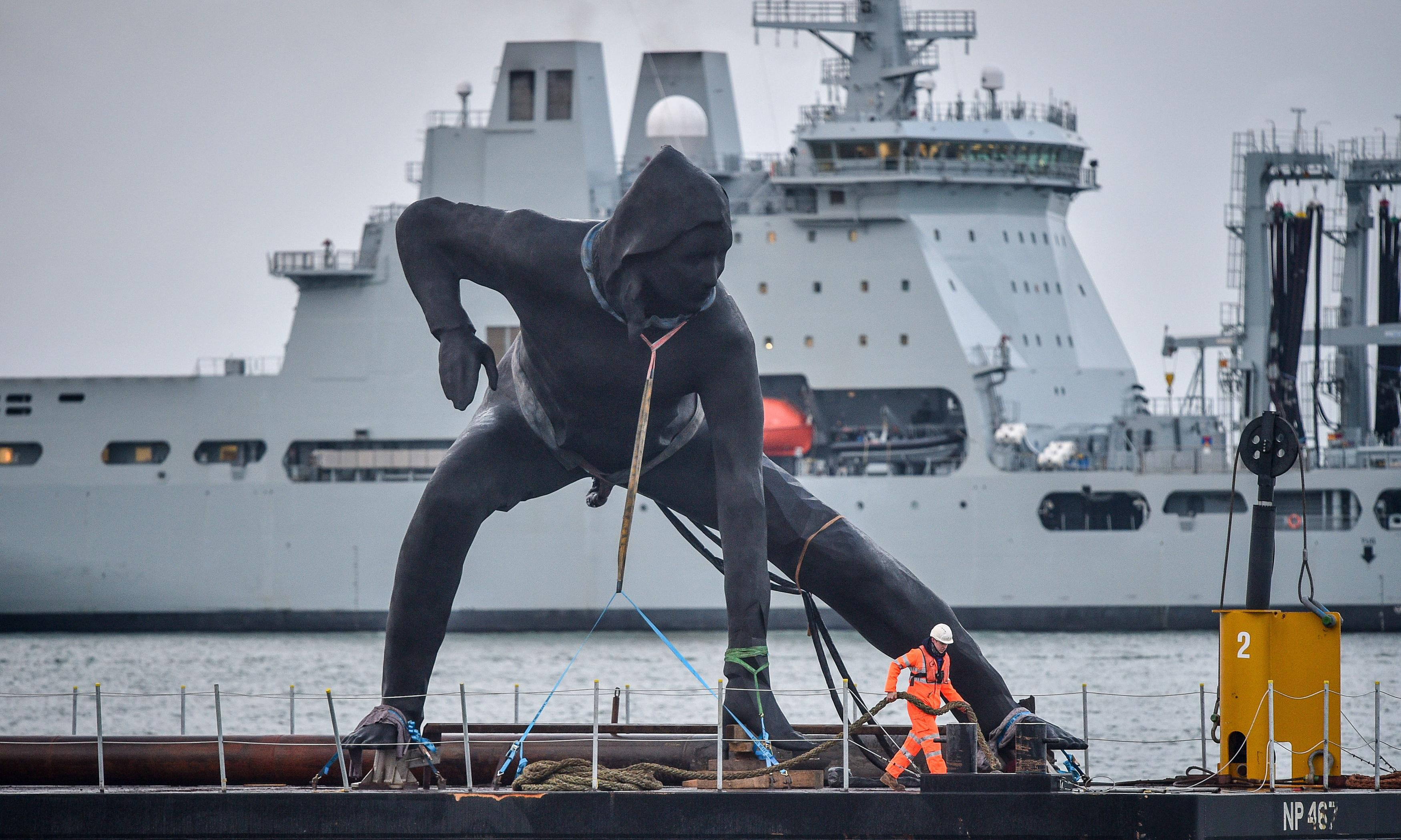 Giant bronze statue of crouching woman arrives in Plymouth