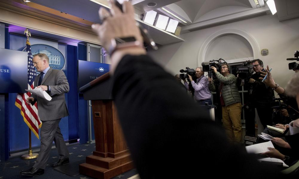 Sean Spicer steps away from the podium without taking questions after speaking at the White House on Saturday.