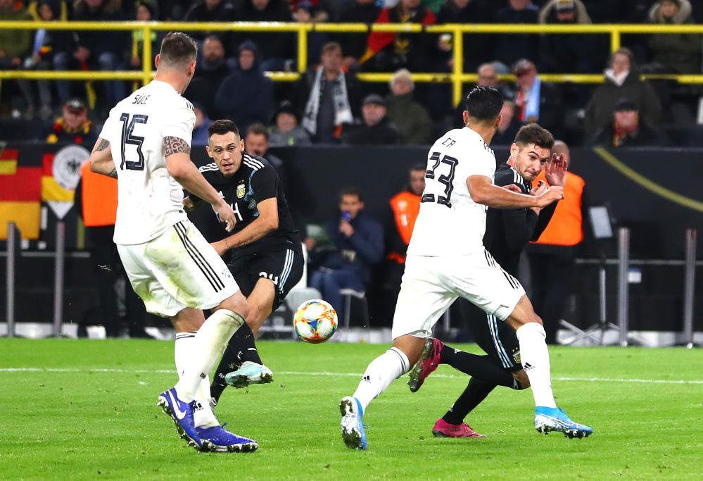 Lucas Ocampos of Argentina scores the equaliser.