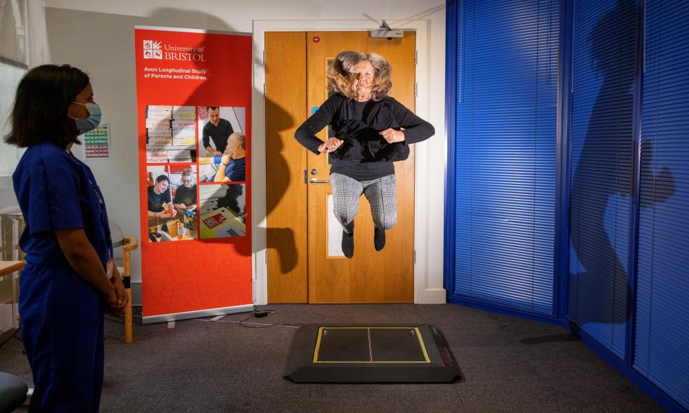 Deborah Burton performs a jumping mechanography test for field worker Vijeta Saxena at the @30 clinic.