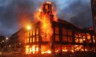 Fire rages through a building in Tottenham, north London as trouble flared after members of the community took to the streets to demand justice, after Mark Duggan, 29, was shot dead by police on Thursday. PRESS ASSOCIATION Photo. Picture date: Sunday August 7, 2011.