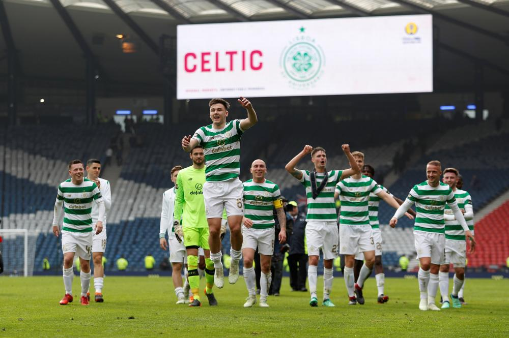 Celtic's Kieran Tierney celebrates with teammates after the match.
