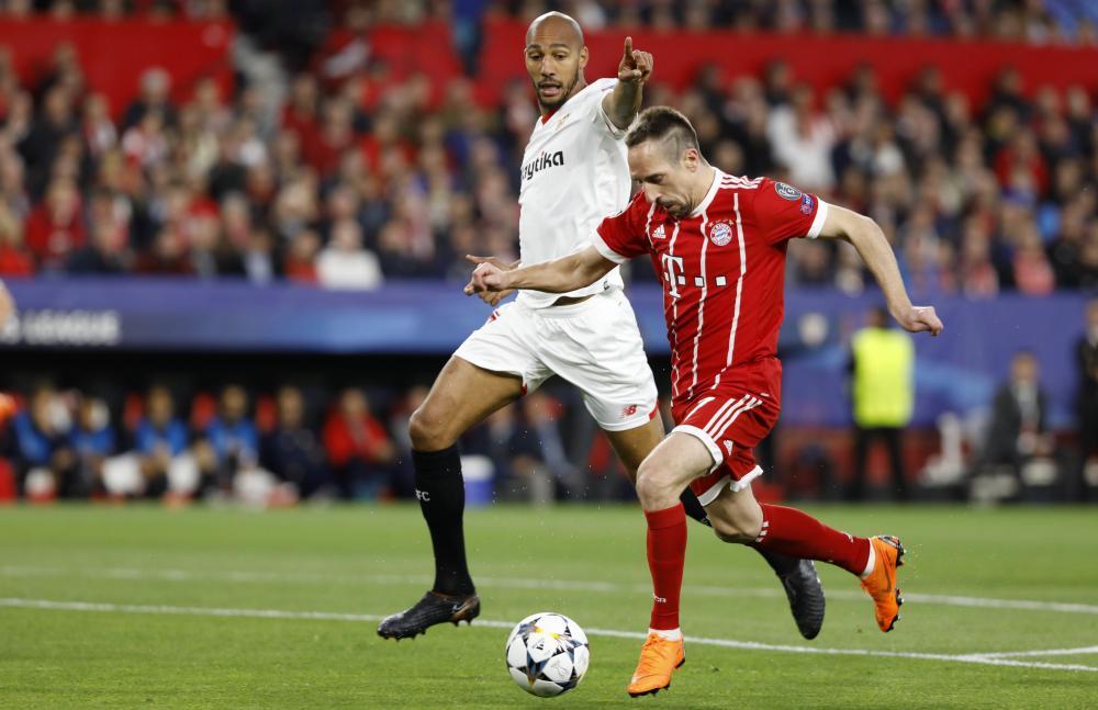 Bayern's Franck Ribery takes on Steven N'Zonzi.
