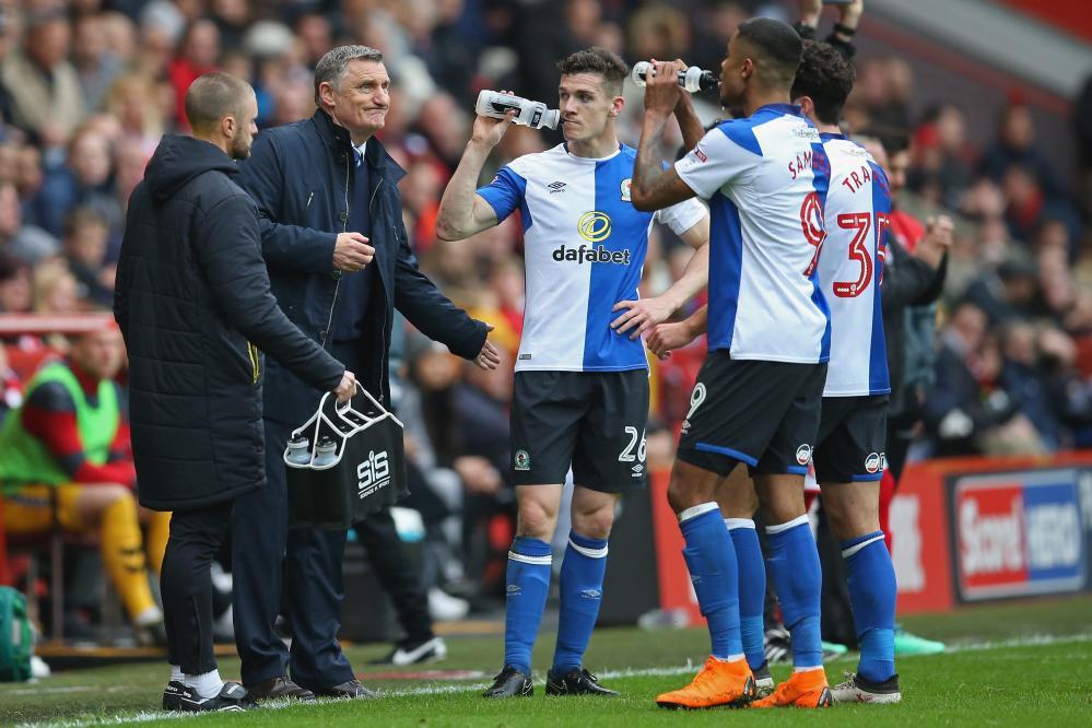 Blackburn manager Tony Mowbray talks to his players.