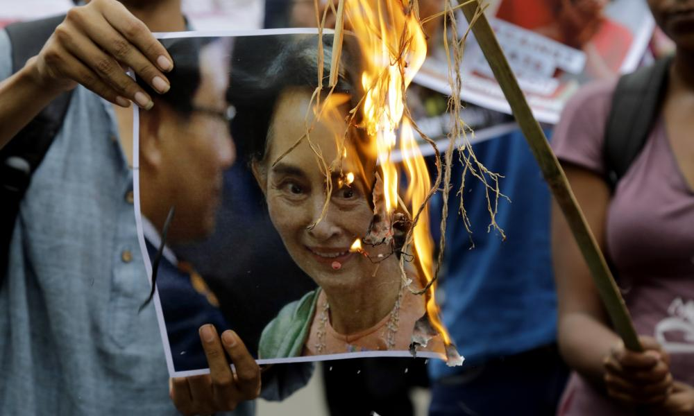 Protesters in Kolkata, India, burn an image of Aung San Suu Kyi