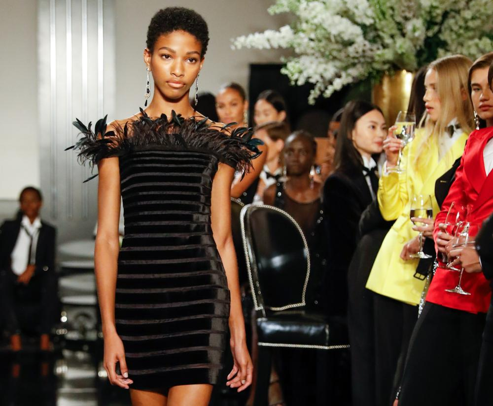 Taking flight: a a minidress erupts with unruly feathers