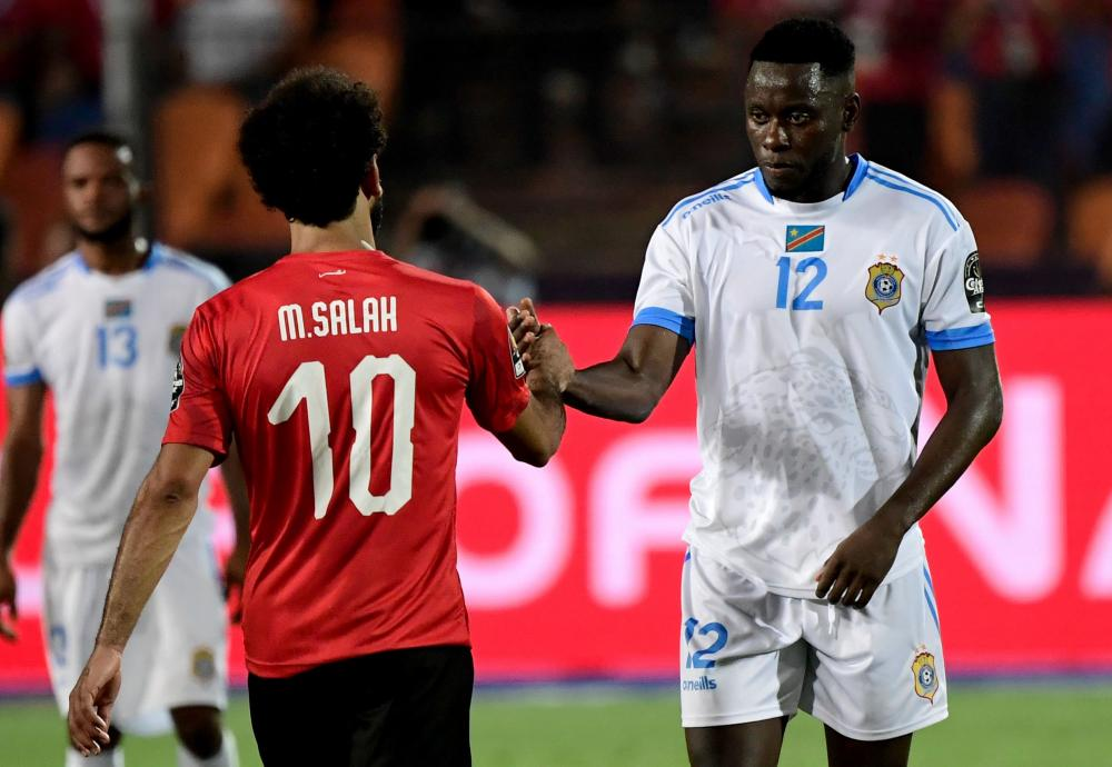 Egypt's forward Mohamed Salah shakes hands with Congo's defender Wilfred Moke.
