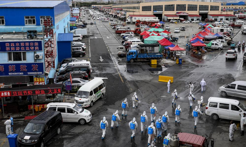 Volunteers disinfect and sterilize amid a new coronavirus outbreak in Urumchi, Xinjiang, China in August.