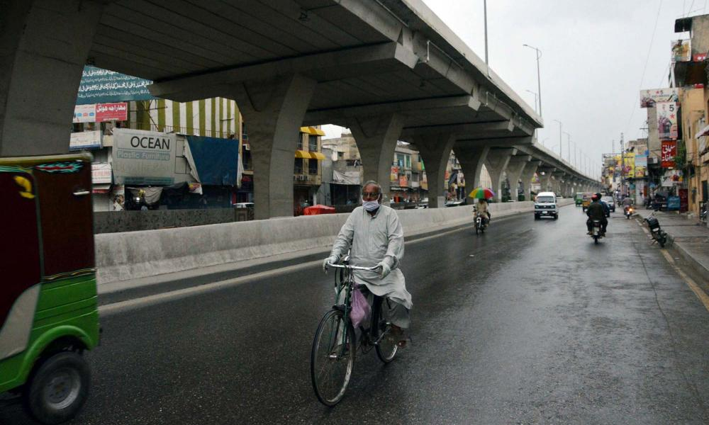 Commuters are passing through a road during a downpour in Rawalpindi, Pakistan, on Saturday,2 May 2020.