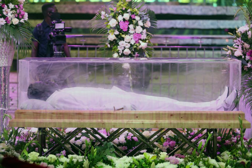TB Joshua's body on display during his funeral in Lagos in July.