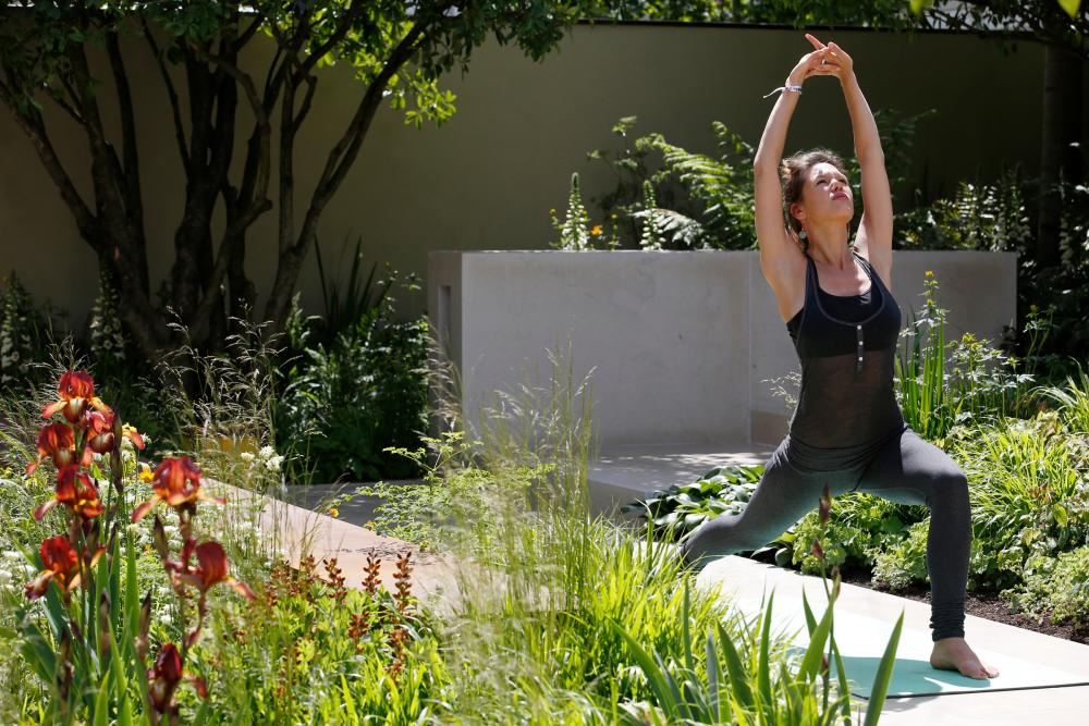 Yoga instructor Fern Trelfa demostrates in the Garden of Mindful Living